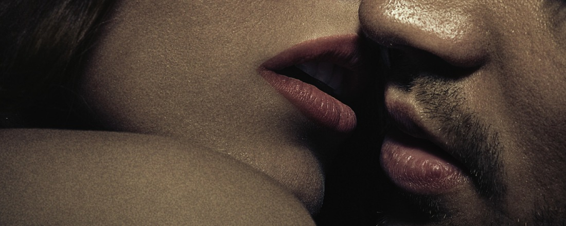 Heterosexual couple ready to kiss. Closeup to the lower part of their faces