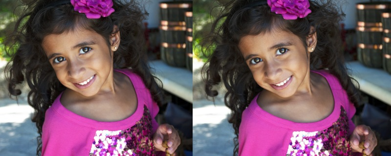 Mia Gonzalez wearing a pink sweater is smiling. Her curly heart is decorated by a pink flower. Photography by Alex Gonzalez